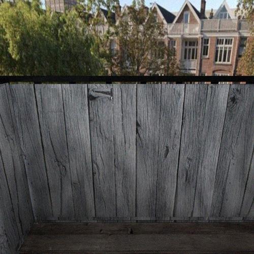 Balkonafscheiding-grijze-stijgerplanken.jpg